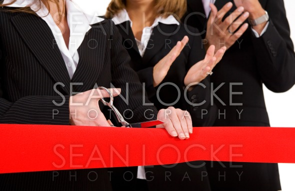Business: Woman Cuts Red Grand Opening Ribbon While Team Applauds Stock Photography Content by Sean Locke