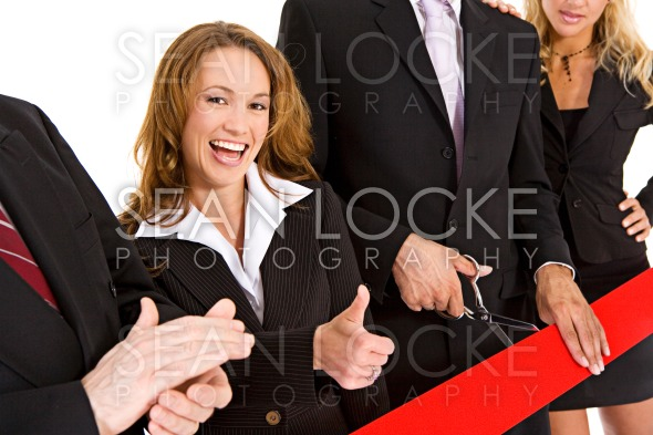 Business: Businesswoman Gives Thumbs Up Stock Photography Content by Sean Locke