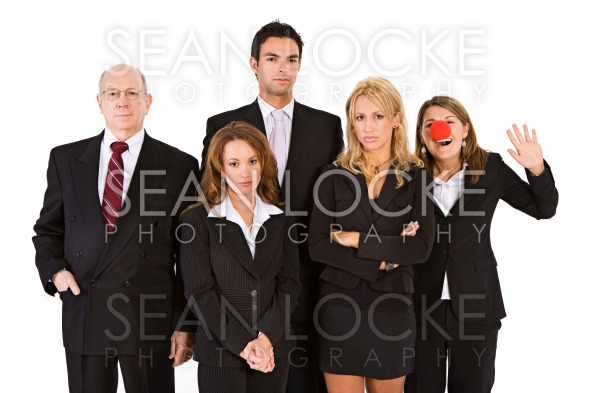 Business: Woman With Clown Nose Having Fun With Serious Team Stock Photography Content by Sean Locke