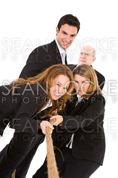Business: Employees Pulling Rope In Tug Of War Stock Photography Content by Sean Locke