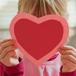 Valentine: Girl Hiding Behind Paper Heart