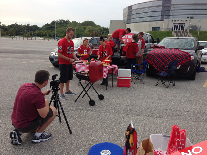Behind the scenes images from a tailgating party stock video session.