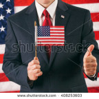 stock-photo-politician-holding-flag-with-a-big-thumbs-up-for-success-408253603